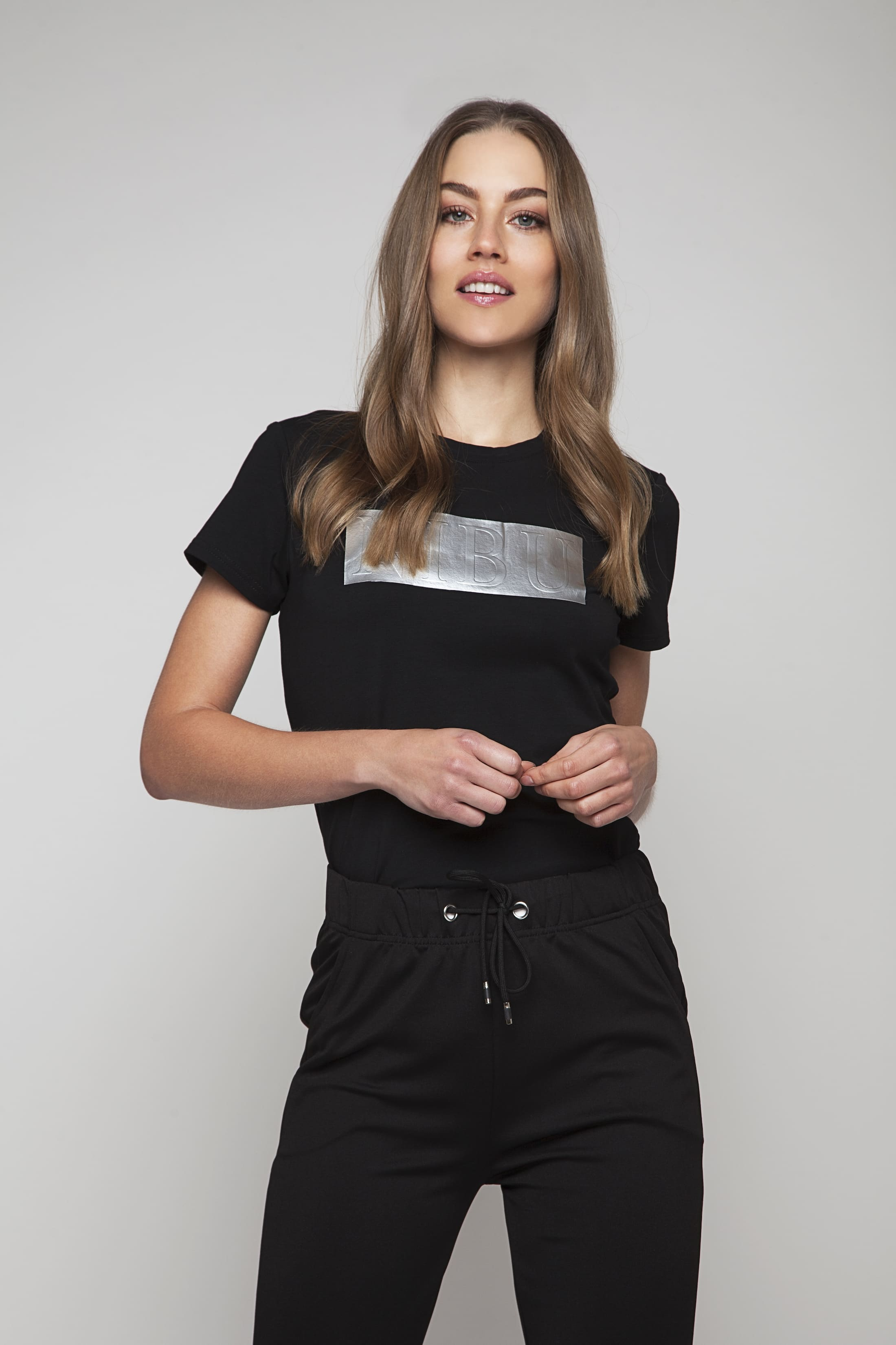 Soft black stretch t-shirt with silver logo